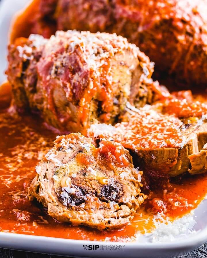 Italian Beef Braciole Recipe with pine nuts, raisins, parsley, parmigiano reggiano, and garlic.