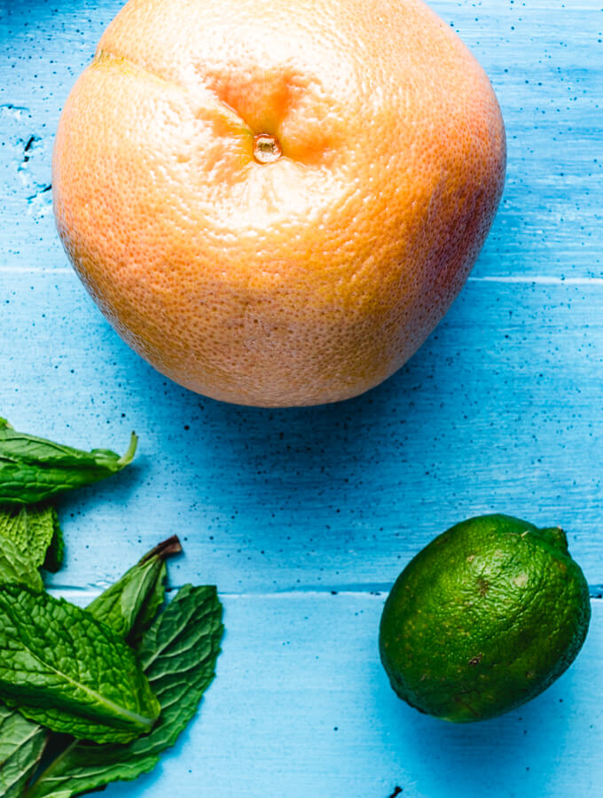 Fresh grapefruit, fresh lime juice, and fresh mint used in the grapefruit mint margarita.