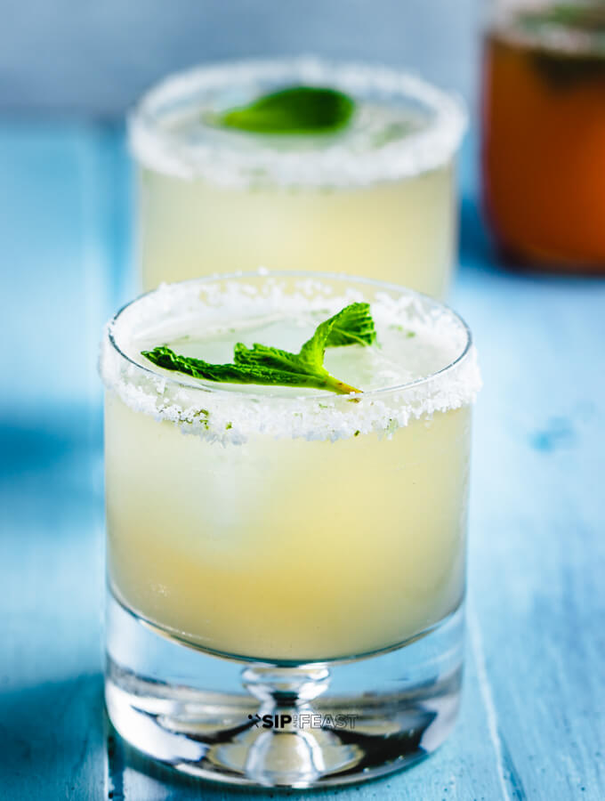 The grapefruit mint margarita with salt around the glass rim.