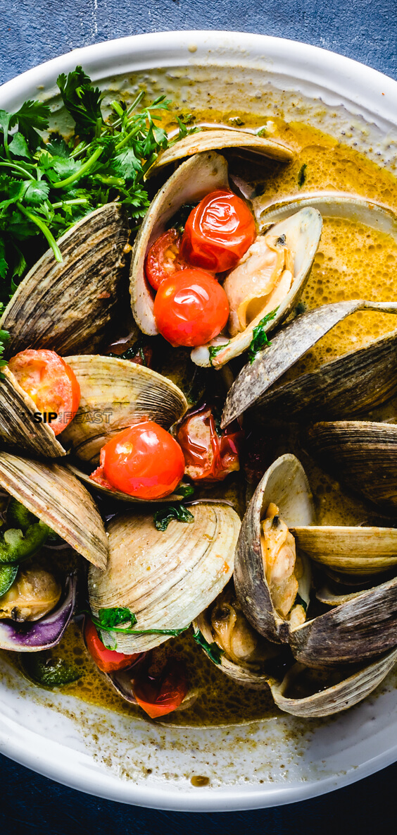 Quick and Easy Thai Green Curry Clams.  Recipe uses Littleneck clams, coconut milk, cherry tomatoes, limes, and cilantro.  Any small clams can be used. #clams #curry #thaifood #seafood #appetizers