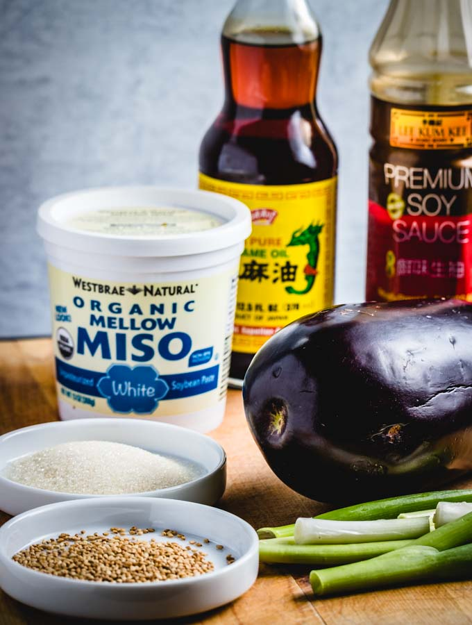 Miso eggplant ingredients with soy sauce, white miso, mirin, sesame oil, green onion, and sugar.