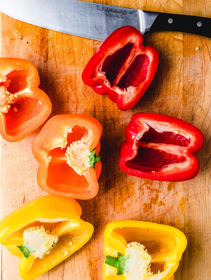 The bell peppers cut in half with the seeds removed.