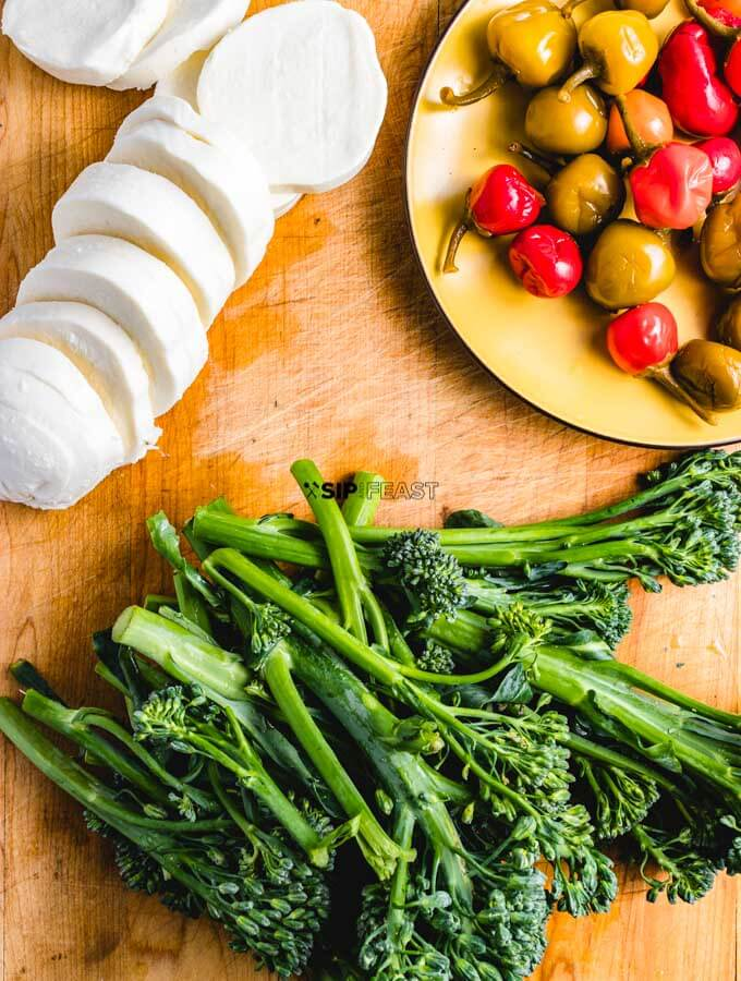 Fresh mozzarella, broccolini, and cherry peppers. Ingredients for the roasted broccolini sheet pan dinner.
