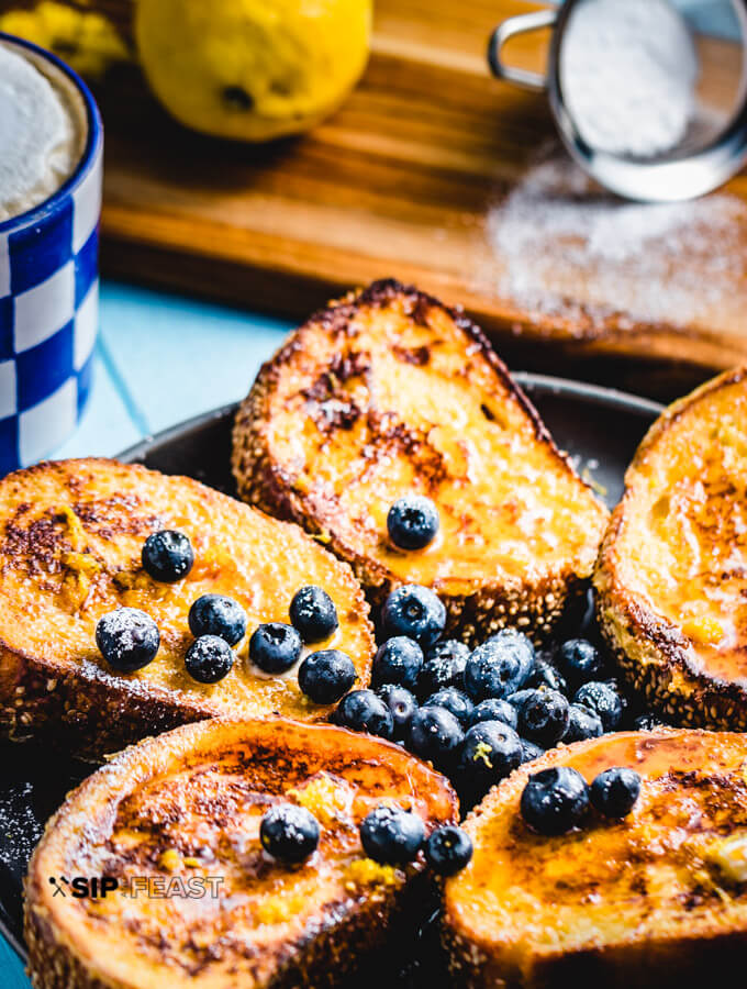Lemon blueberry french toast made with semolina bread, fresh blueberries, and lemon zest.
