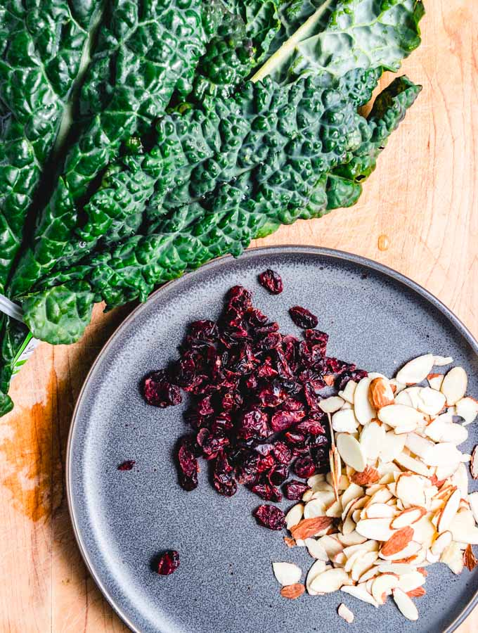 Slivered almonds, cranberries, and fresh kale.