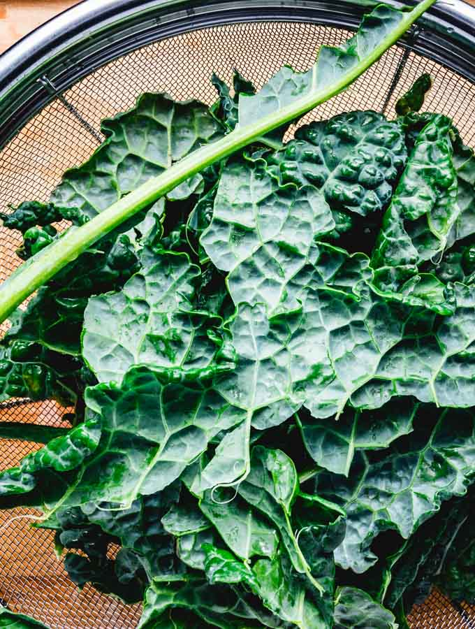 Kale image showing how to take leaves off stems.