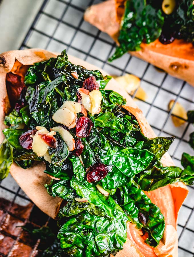 Featured Image of the Loaded Sweet Potatoes With Kale And Cranberries.