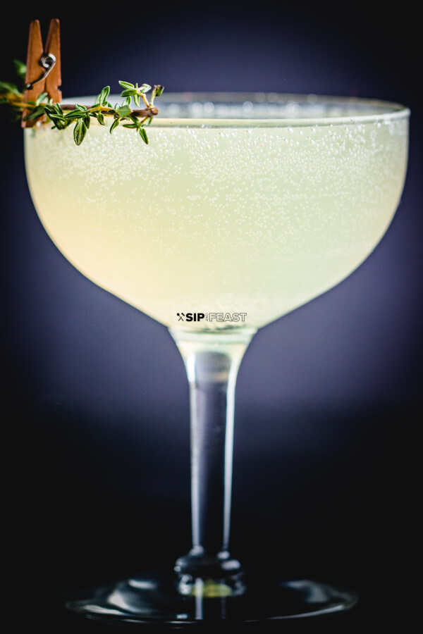 Sparkling Lemon Thyme Cocktail.  Summer time cocktail with thyme infused vodka. ~ Drink Recipe ~ Cocktail ~ Summer Drink ~ #cocktails #drinkrecipe #vodkadrink # Beautifuldrink #cocktailrecipe