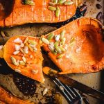 Roasted butternut squash with brown sugar cut open in pan.