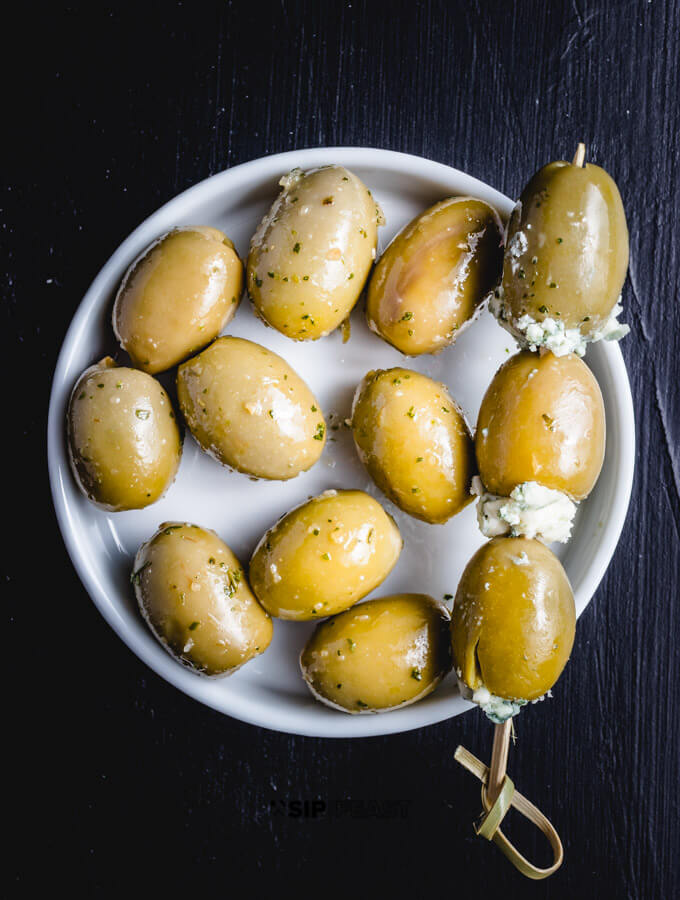 Blue cheese olives in a dish.