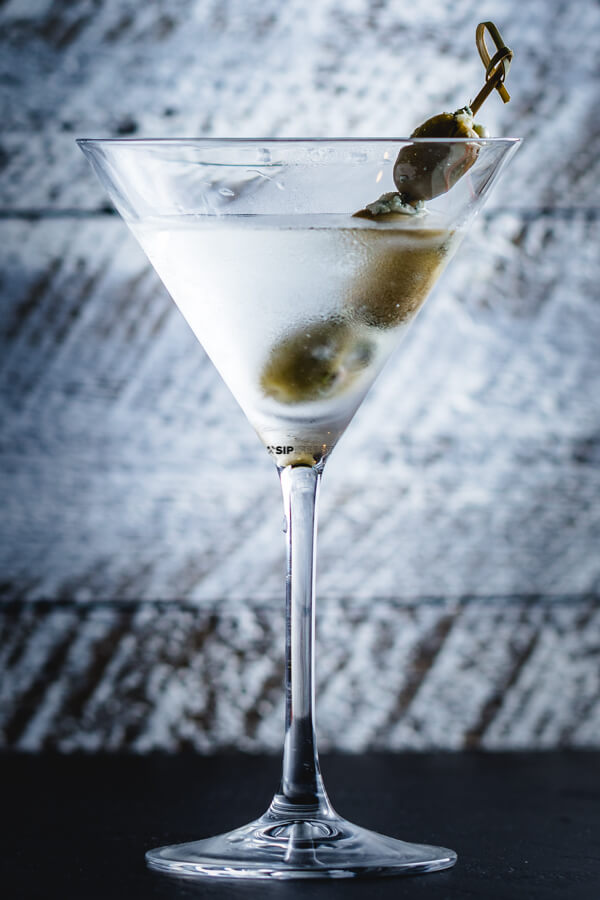 Pinterest pin of Classic martini with blue cheese stuffed olives.