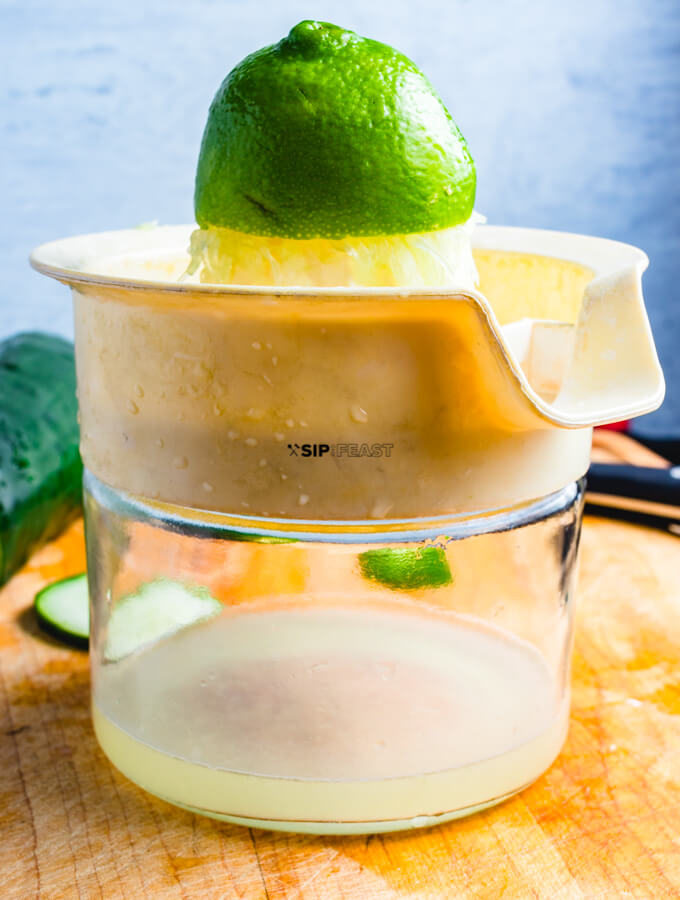 Lime being squeezed for juice.