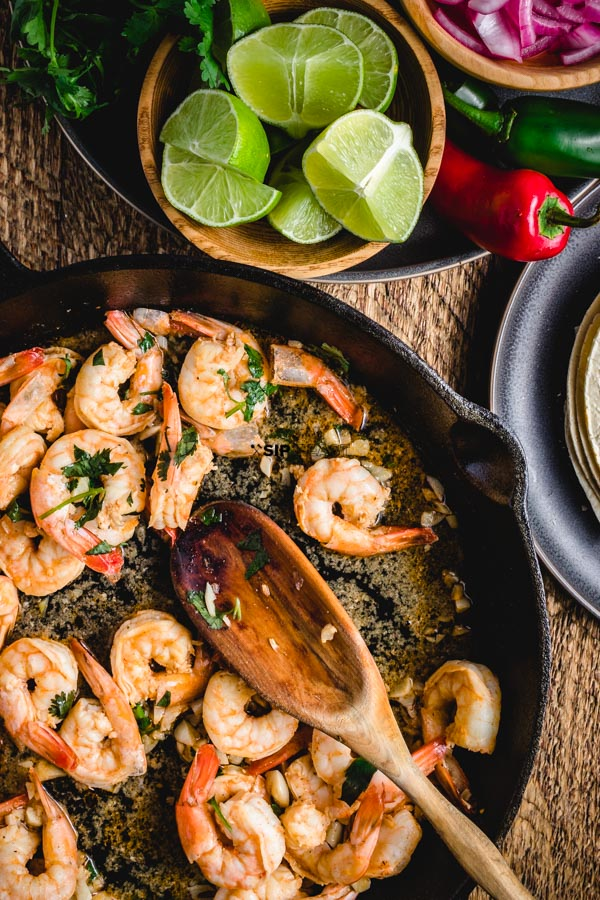 Shrimp taco recipe with a delicious cilantro, lime, and tequila garlic sauce. The whole dish takes less than 30 minutes to prepare. #shrimp #tacos #garlic #lime #tequila #mexican #tacotuesday #tortillas #dinner #lunch #recipe