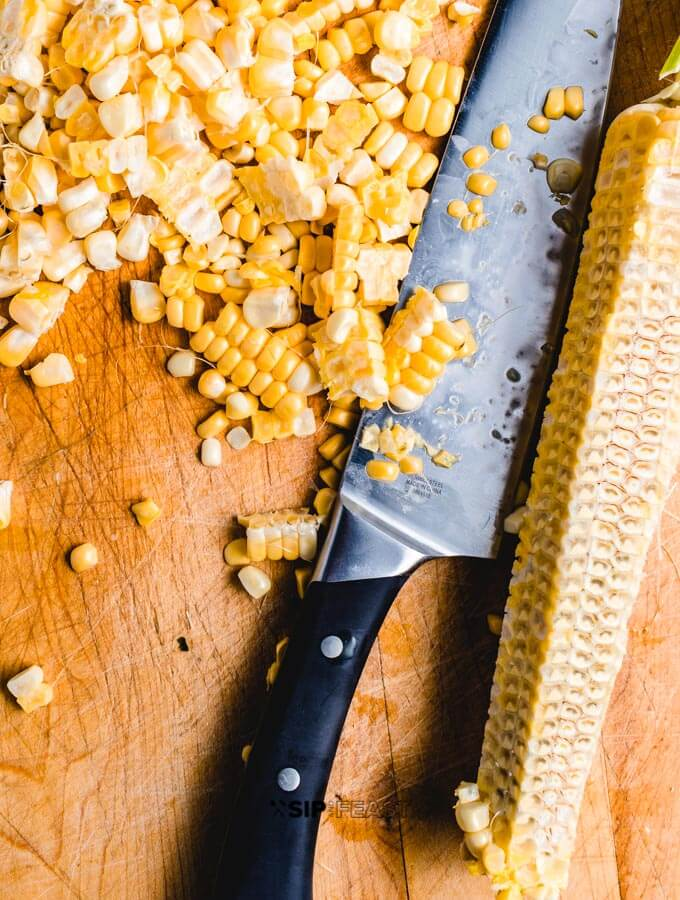 Cut corn kernels for the Mexican street corn salad.