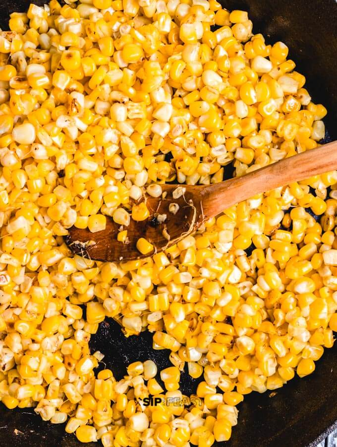 Corn kernels seared in cast iron pan.