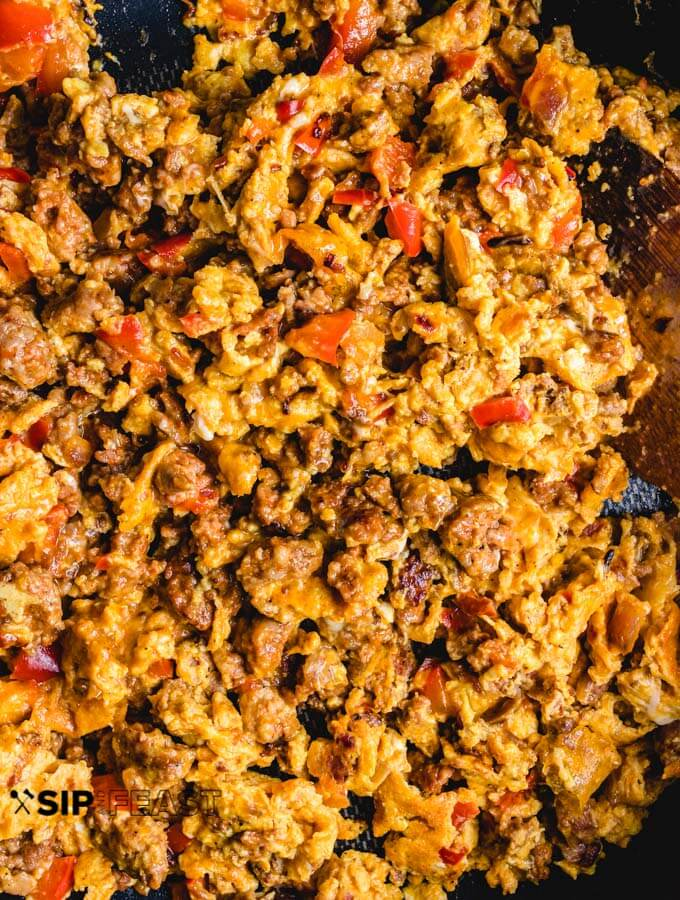 Chorizo and eggs finished cooking in pan.
