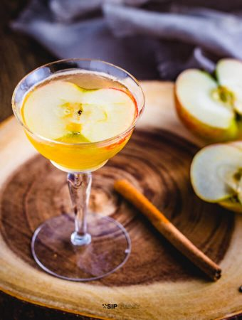 Apple cider cocktail with maple syrup and bourbon featured image.