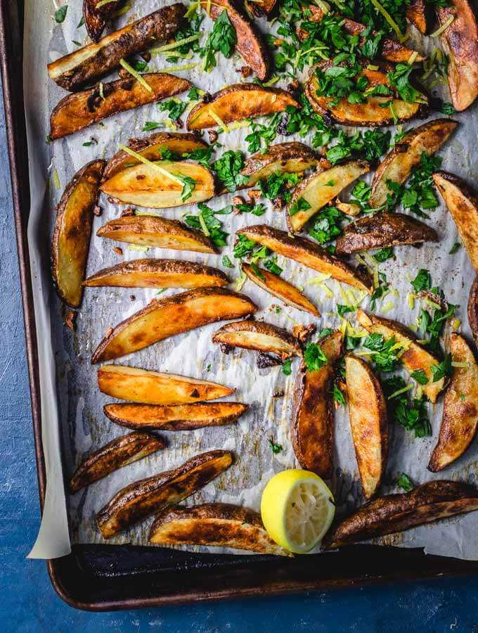 The crispy roasted potatoes are finished with some fresh squeezed lemon and parsley.
