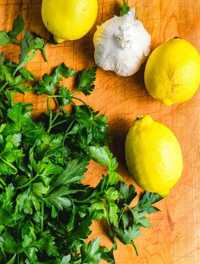 Lemon, parsley, and garlic for the crispy roasted potatoes.