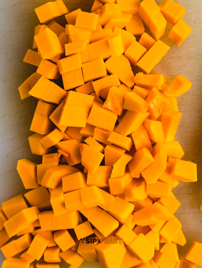 Chopped butternut squash on cutting board.