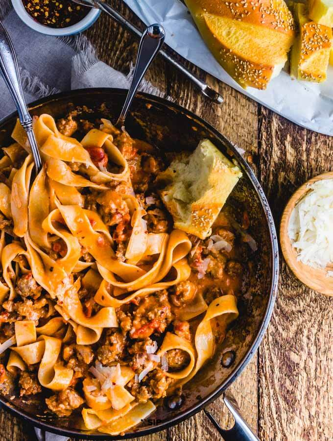 Sweet Italian sausage pasta in cream sauce featured image.