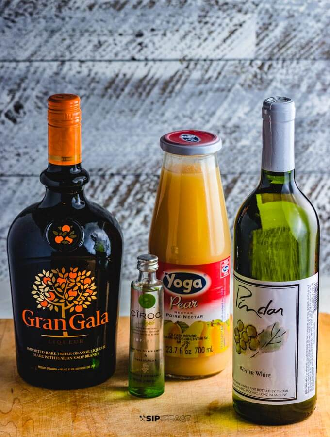 The ingredients: Gran Gala, bottle of white wine, bottle of pear nectar and bottle of apple vodka.