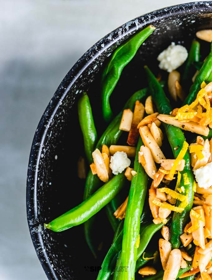 Close up shot the Green beans almondine with feta.