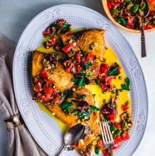 Pan seared swordfish steaks with olives and capers featured recipe card image.