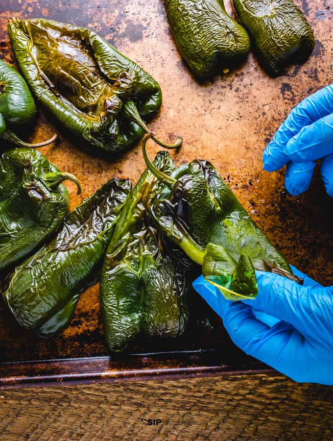 Roasted poblano peppers being peeled.