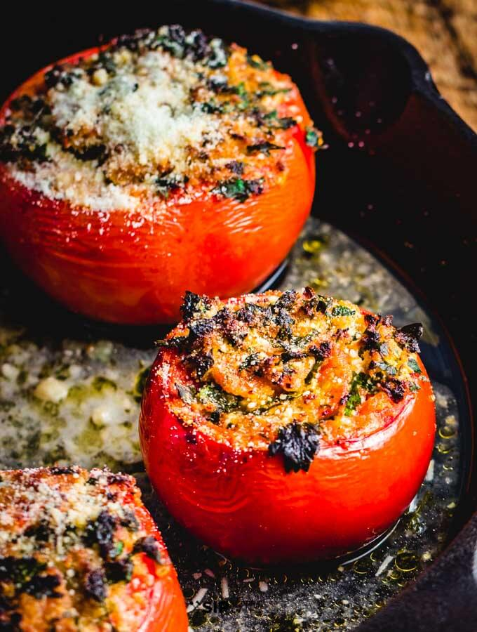 Stuffed tomatoes with ricotta salata in cast iron pan.