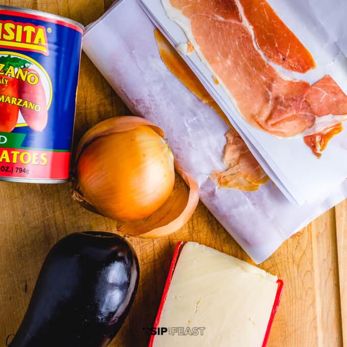 Plum tomatoes, onion, eggplant, prosciutto, and fontina cheese for chicken sorrentino recipe