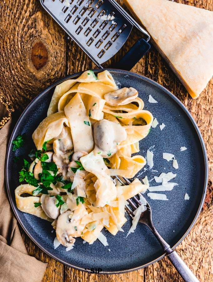 Creamy garlic mushroom pasta plated overhead shot.
