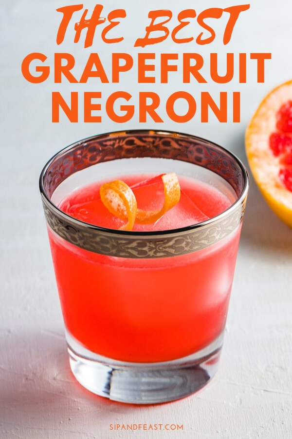 Do you love Negronis but want to change it up a bit? This Grapefruit Gin Cocktail does just that using the flavors of the classic Negroni as its base with the addition of some fresh squeezed grapefruit juice to make a great holiday cocktail. #cocktailrecipe #drinkrecipe #gincocktail #camparicocktail #grapefruitdrinks #mixeddrink