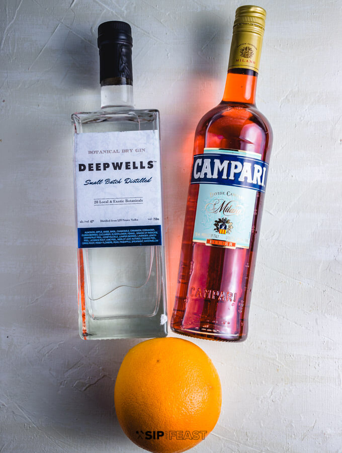 Bottle of gin, Campari and a grapefruit