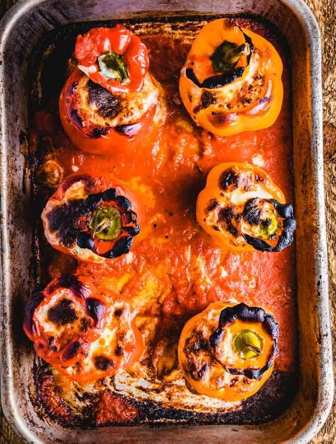 Italian stuffed peppers in pan.