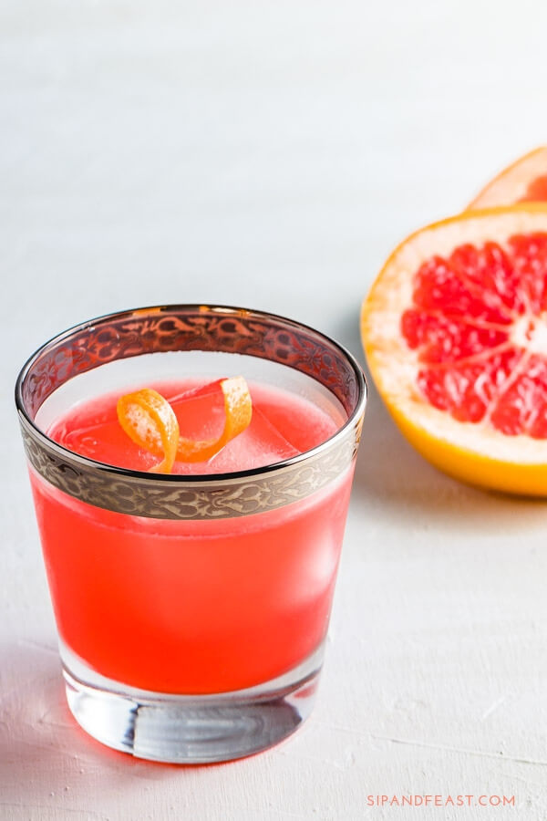 Do you love Negronis but want to change it up a bit?  This Grapefruit Gin Cocktail does just that using the flavors of the classic Negroni as its base with the addition of fresh squeezed grapefruit juice to make an awesome cocktail. #cocktailrecipe #drinkrecipe #gindrink #campari #grapefruitdrinks #mixeddrinks