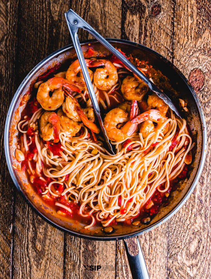 Shrimp fra diavolo finished in pan.