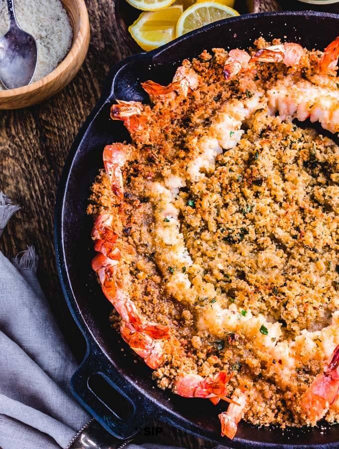 Shrimp oreganata in cast iron pan.