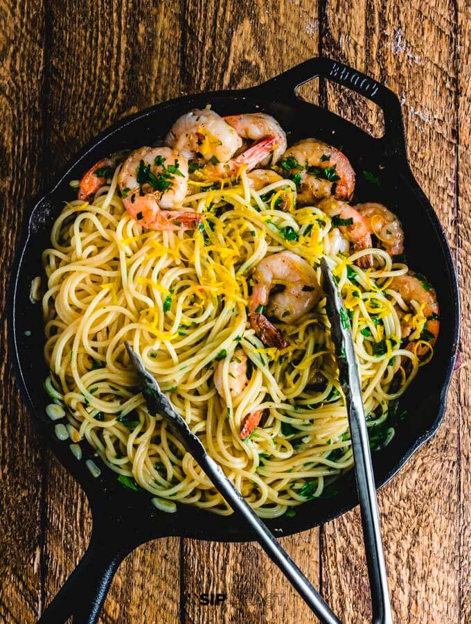 Lemon garlic shrimp pasta in the pan on table.