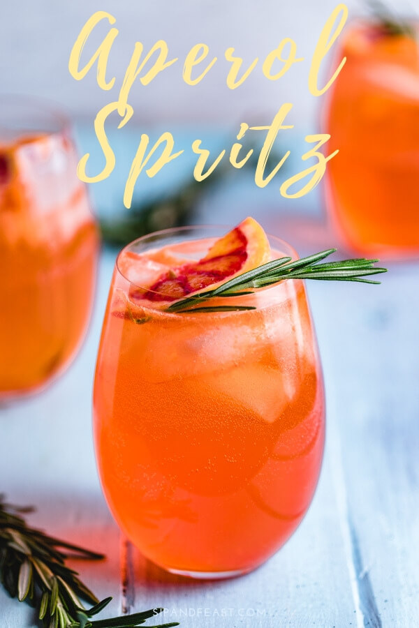 The Aperol Spritz is a super refreshing cocktail!  Great for parties, barbecues, and group events.  This easy mixed drink should definitely be in your rotation!  #sipandfeast #cocktails #aperol #aperolspritz #spritz #mixeddrink #italiandrinks