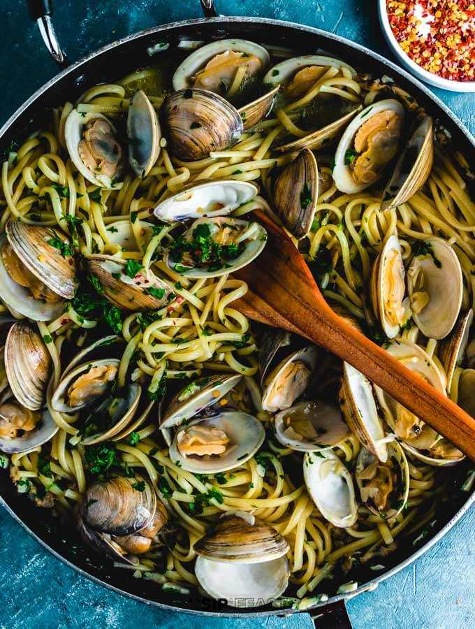 Liguine alle vongole in pan finished shot.