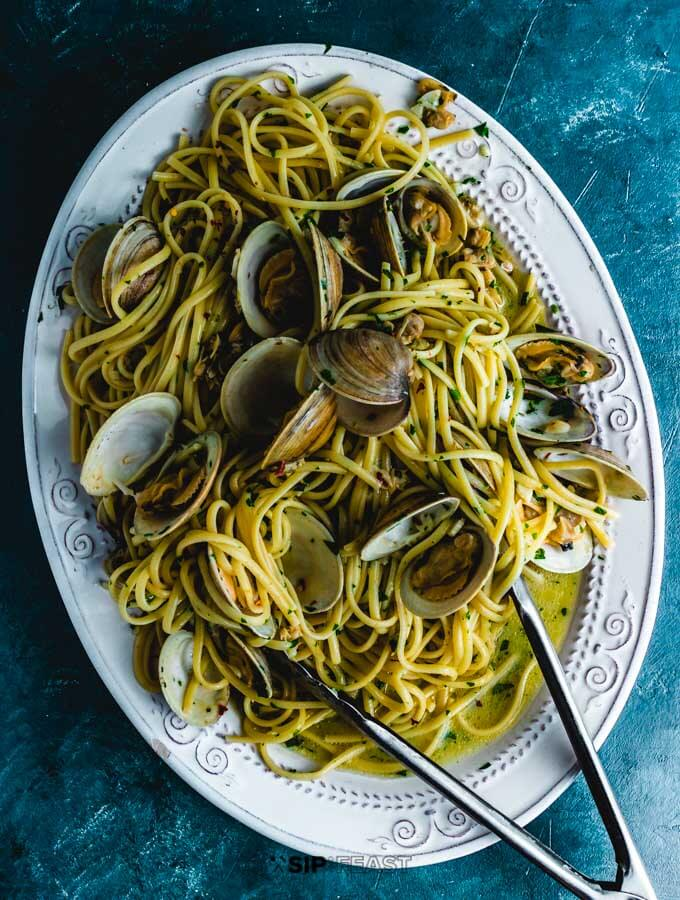 Linguine alle vongole plated in large platter.