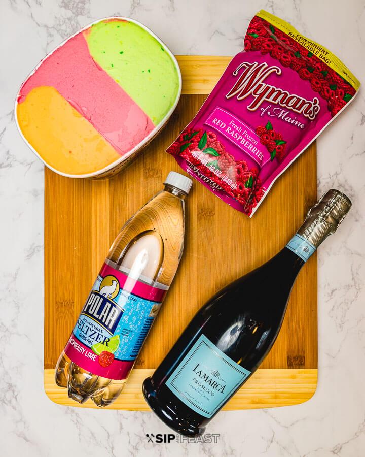 Ingredients: rainbow sherbet, frozen raspberries, seltzer and prosecco.