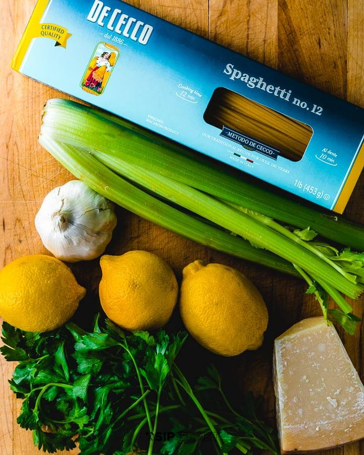 Ingredients shown: pasta, celery, garlic, lemons, parmigiano reggiano and parsley.