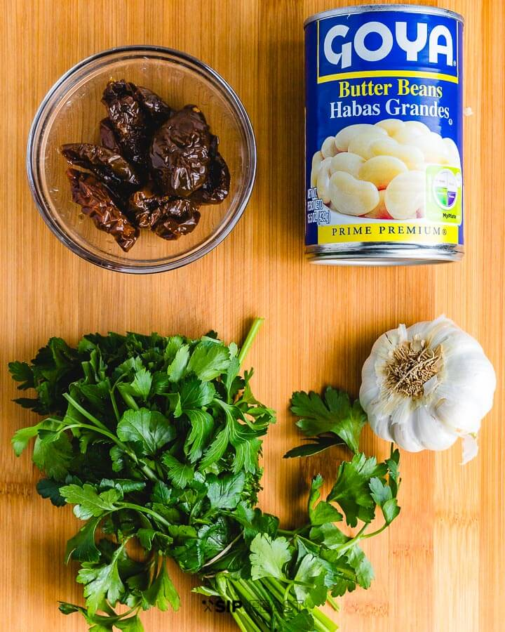 Recipe ingredients shown: butter beans, sundried tomatoes, parsley and garlic.