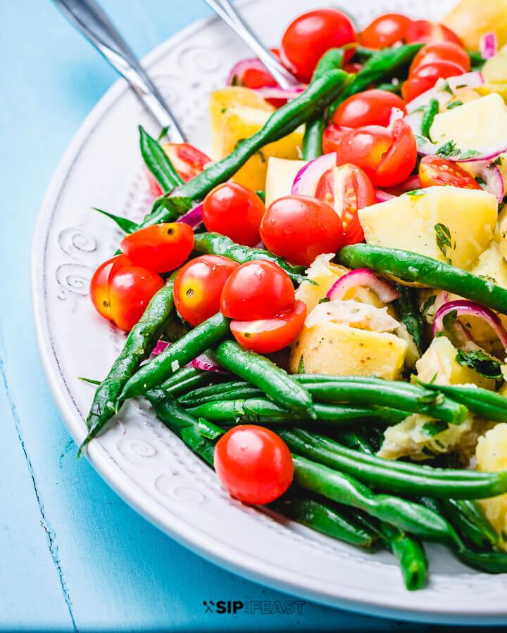 Salad plated on blue table.