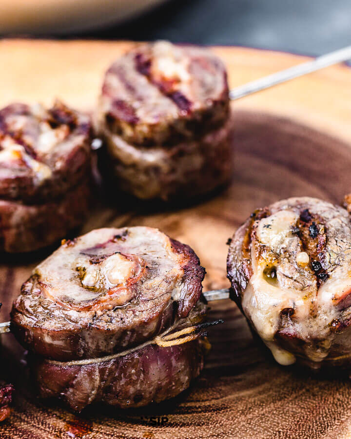 Steak pinwheels on cutting board.