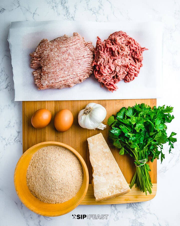 Ingredients shown: ground pork, ground beef, eggs, garlic, breadcrumbs, parmigiano reggiano and parsley.