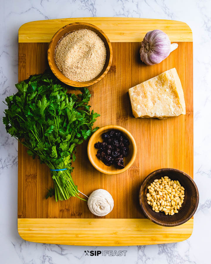 Ingredients shown: breadcrumbs, garlic, parsley, parmesan, raisins, pine nuts and kitchen twine.