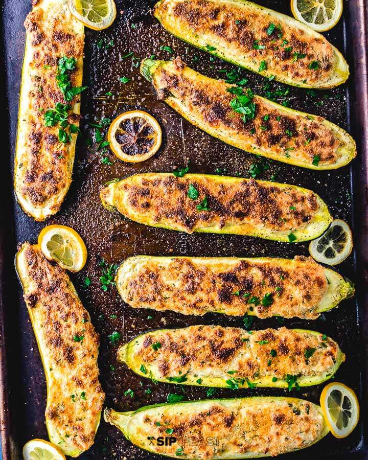 Overhead shot of stuffed zucchini boats in sheet pan.
